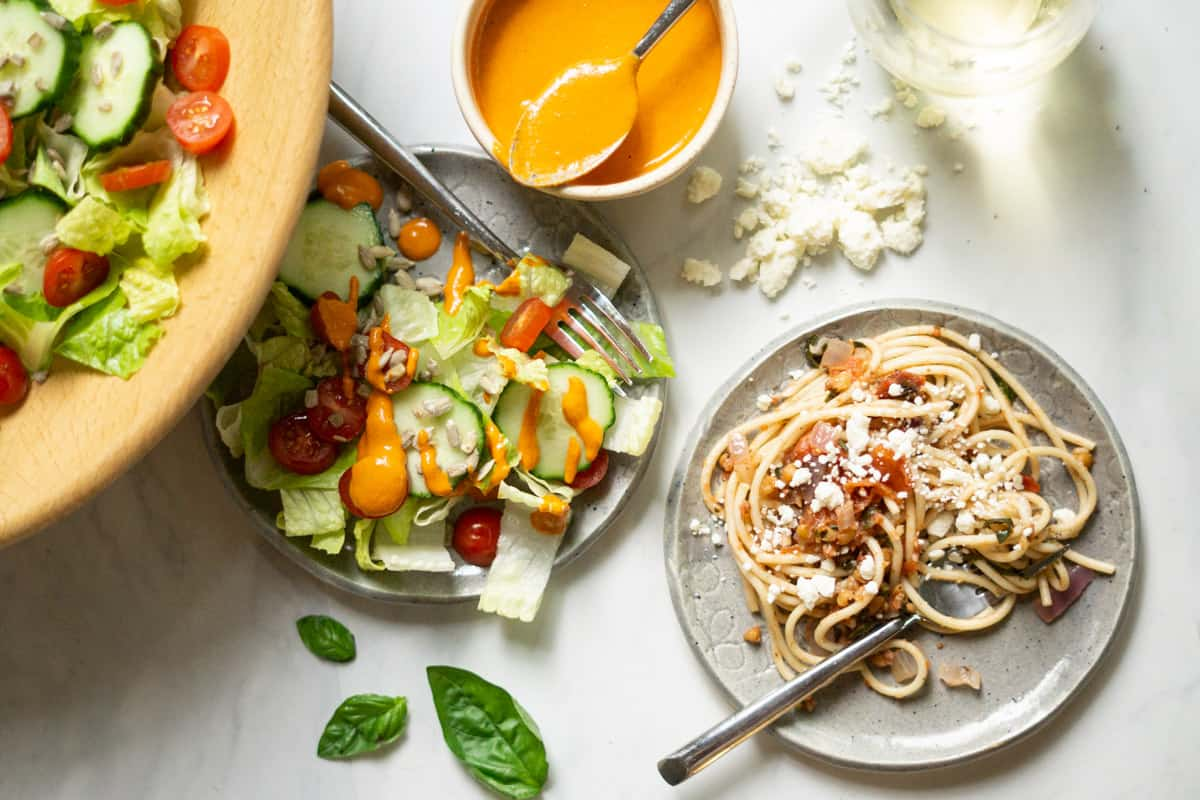garden salad with roasted red pepper dressing and a plate of summer spaghetti