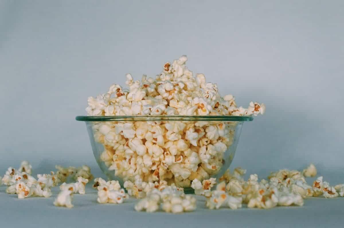 repurpose halloween candy to make skittle popcorn