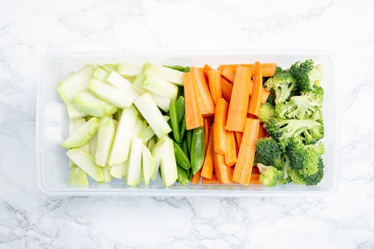 Veggie Box with kohlrabi, snap peas, carrots, and broccoli