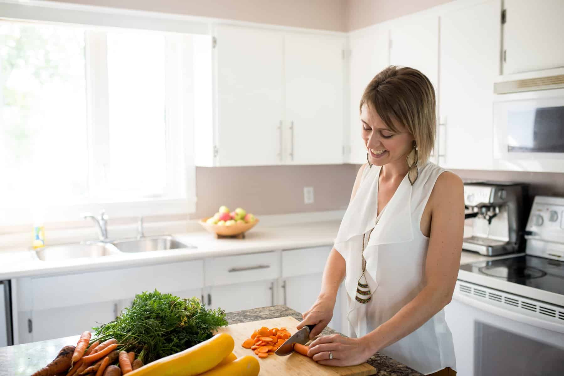 Jessica Penner, Registered Dietitian, chopping veggies in a kitchen