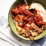 bowl of oatmeal with rhubarb compote and pecans