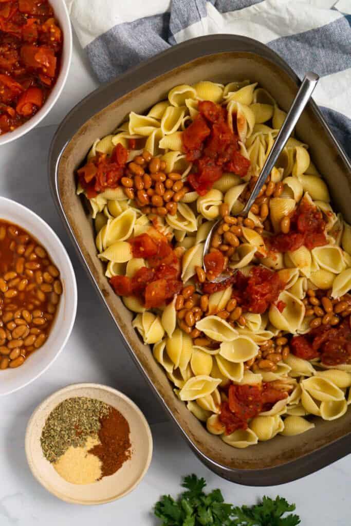 Image of assembling the tomato bean pasta bake.