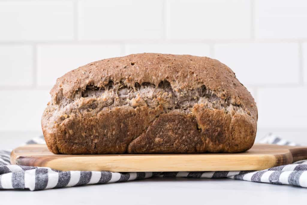 the side view of a loaf of vegan sourdough bread