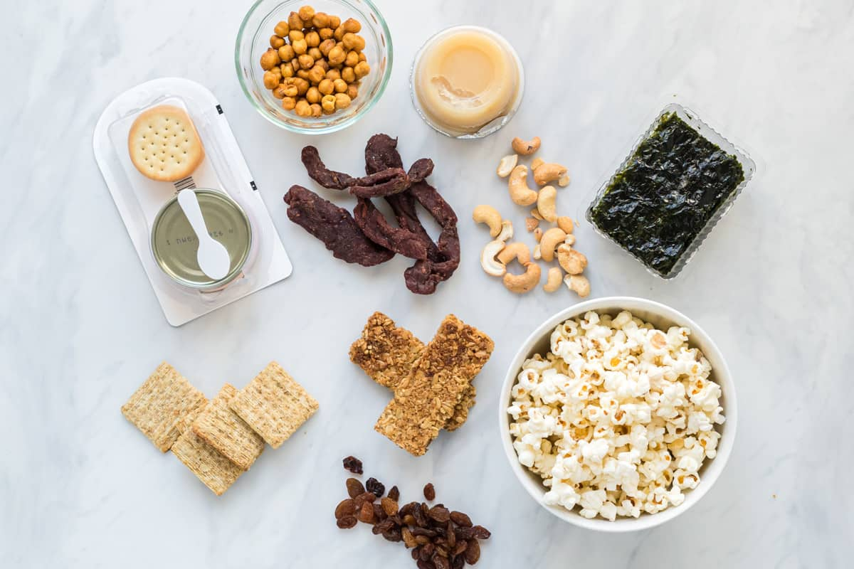 A flatlay image of a Dietitian's top choices for packaged snacks