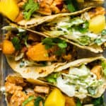 Closeup image of chicken pineapple tacos on a sheet pan